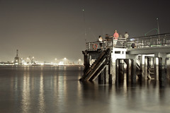 moving stillness (emilyTAN) Tags: sea sky people water way lights moving fishing ships punggol stillness