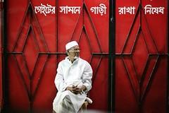 The RED gate (N A Y E E M) Tags: street red portrait night gate candid oldman ramadan bangladesh carwindow chittagong mmaliroad