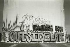 osl (_unfun) Tags: film analog 35mm outside graffiti oakland bay pentax k1000 area late osl