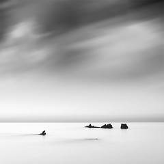 The Crocodile Goes Hunting (DavidFrutos) Tags: longexposure sea bw costa seascape beach water monochrome rock clouds sunrise square landscape monocromo coast mar agua rocks playa paisaje bn minimal amanecer filter le lee nubes minimalism minimalismo cdiz canondslr roca rocas confluence 1x1 filtro largaexposicin filtros nd8 neutraldensity canon1740mm graduatedneutraldensity laalcaidesa densidadneutra davidfrutos 5dmarkii niksilverefexpro hitechreversegnd06