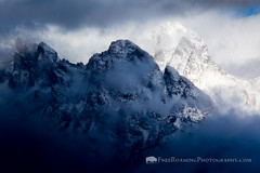 Snow-Capped Teton Peaks (Free Roaming Photography) Tags: autumn winter light shadow usa cloud mountain snow storm mountains cold west fall weather fog clouds nationalpark cloudy foggy dramatic peak stormy western northamerica kelly wyoming peaks teton tetons storms drama grandteton rugged clearing grandtetonnationalpark