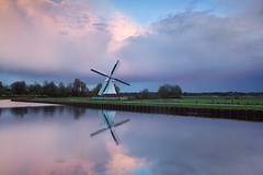 Pink rainy sunset over windmill by river (Olha Rohulya) Tags: pink blue autumn sunset sky cloud holland reflection fall nature water netherlands ecology windmill dutch rural sunrise river landscape outside outdoors evening countryside canal scenery energy silent view sundown pastel horizon scenic meadow culture nobody nopeople surface farmland reflect rainy pasture environment groningen plain tranquil cloudscape creamy
