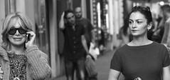 Nervous smile (Baz 120) Tags: life street city portrait people urban blackandwhite bw italy rome monochrome candid streetphotography streetportrait monotone streetphoto unposed 45mm decisivemoment candidportrait streetcandid mft primelens candidstreet thephotographyblog