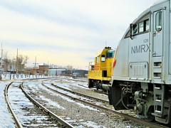 The Railrunner and Diesel Locomotive (Patricia Henschen) Tags: railroad newmexico santafe station depot locomotive railyard railrunner