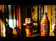 Books and US (shan turrenz) Tags: street shadow red summer stilllife sun sunlight colour green art face yellow sunrise canon reading design eyes photographer god goddess books kitsch footwear rays shan mumbai ethnic props rajastan indianart bottleart framers chappal indiandesign kitschart baffel displayitems turrenz shanturrenzphotography shanturrenz wwwframersin wwwshanturrenzcom bottlepaint artificialreader