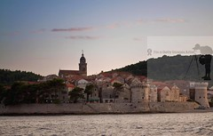 Scenic view of city of Korcula in Croatia (Sebastian Condrea) Tags: old city blue red sea vacation sky moon tourism water beautiful stone architecture night buildings reflections boats island lights town ancient europe mediterranean dusk small scenic croatia historic full clear moonrise shore destination korcula residential fortress adriatic dalmatia corcula vision:sunset=0682 vision:outdoor=099 vision:clouds=0656 vision:car=0512 vision:sky=0915