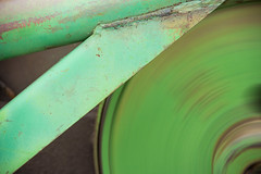 abstract blur metal rust antique farm equipment flywheel bailer happystpaddysday