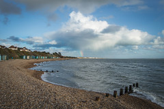 Rainbow Strike (NVOXVII) Tags: rainbow spectrum clouds coast beach groyne waves landscape bluesky nikon outdoor weather spring seafront rain shower