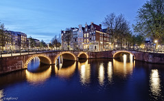 Amsterdam. (alamsterdam) Tags: canal amsterdam evening bluehour longexposure reflections bridges architecture facades lights