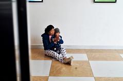 Waiting for the lift (Roving I) Tags: boys babies sitting floor women socks spots dots squares tiles caps lifts elevators shoppingcentres malls vincomcenter danang vietnam