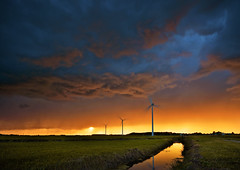 Sunset Storm (martijnvdnat) Tags: dutch netherlands rain windmill aerofoilpoweredgenerator agriculture climate clouds dark dramatic electricalpower electricity energy evening field generator gloomy grassland horizon kineticenergy ominous overcast polder power renewableenergy rural storm sunset sustainable turbine weather wind windpower windfarm windturbine windpowered alphenaandenrijn zuidholland nederland