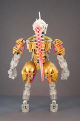 Freya - Back (0nuku) Tags: bionicle lego toa crystal quartz pink gold clear crast kanohi custom mask prosthetics amputee