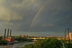 Rainbow over the milling district (schwerdf) Tags: bridges cloudscapes endlessbridge goldenhour guthrietheater hdr i35wstanthonyfallsbridge millingdistrict minneapolis minnesota rainbows southeaststeamplant tcrt thunderclouds