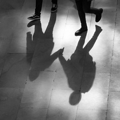 Together (John St John Photography) Tags: grandcentralterminal streetphotography candidphotography 42ndstreet vanderbiltavenue lexingtonavenue shadows silhouette couple walking holding hands people peopleofnewyork blackandwhite blackwhite bw johnstjohn