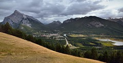 Banff View Point or One Heck of a View Across Banff with Views to Mount Rundle, Sulphur Mountain, and the Canadian Rockies (thor_mark ) Tags: banff banffnationalpark banffviewpoint canadianrockies capturenx2edited colorefexpro day2 goatrange goatviewpeak lookingsse mountnorquayscenicdrive mountrundle mtnorquayrd nikond800e road rockymountains rundlepeaks sansonpeak southbanffranges southerncontinentalranges sulphurmountain triptoalbertaandbritishcolumbia vermillionlakes bowriver lake river intersection highwayintersection transcanadahighway transcanadahighway1 transcanadianhwy1 outside nature landscape overcast rollinghillsides mountains mountainsindistance mountainsoffindistance hillsides trees hillsideoftrees evergreens grassymeadow bowvalley citystreets street canvas portfolio project365 alberta canada