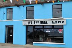 Off The Hook (JulieK (enjoying Spring in Co. Wexford)) Tags: hww blue window reflections door duncannon ireland irish street bunting sign canoneos100d windowwednesday 2017onephotoeachday