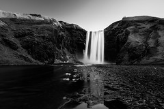 Skógafoss (miguel_lorente) Tags: landscape water sony explore rocks blacknwhite iceland sonyalpha skógafoss waterfall travel longexposure landmark bw blackandwhite bnw reflection zeiss stones