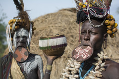 Mursi (Paolo Cinque / www.paolocinque.it) Tags: photo photography photographer shot image beautiful portrait retrato people fantastic nice cool perfect composition world worldwide discover discovery reportage reporter camera flickr dx dlsr reflex awesome stunning travel traveler traveller travelling traveling visit n visiting sight sightseeing tribe tribes poor journey trip tour tourist tourism mursi lips mouth woman women ethiopian ethiopia africa african terrific omo omovalley omoriver village