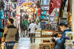 Guests bustle around the shops at the Grand Bazaar, located in Istanbul, Turkey. The Grand Bazaar is the largest covered shopping area in the world, and attracts up to 250,000 guests daily. (Remsberg Photos) Tags: istanbul turkey grandbazaar bazaar commerce shopping guests tourists locallife forsale products handmade goods colorful bright covered traditional busy browse signage hall selection abundance shops storefront vendor walking tur