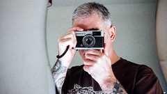 Trip Selfie (Howie Mudge LRPS BPE1*) Tags: me myself i selfie mirror reflection tattoos lowlight olympus olympustrip35 fujicolor fujicolorc200 color colour negative scan epsonv550 35mm film camera photography photographer pointandshoot