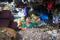 A woman on her shop at Pasa Cacranegara (Sitoo) Tags: cacranegara indonesia lombok mataram pasar southeastasia asia asian island market offthebeatenpath people portrait products seller shop shopkeeper travel woman