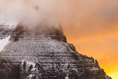 Tempest (Bob Bowman Photography) Tags: mountain gnp landscape sunrise morning glaciernationalpark montana snow peak clouds sky light nationalpark nikon