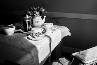 Shadows wash the room | as we sit and drink our coffee