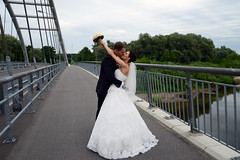 kiss on the bridge (Dmitry Kaminsky) Tags: bridge flowers wedding love happy bride kiss couple joy young marriage husband latvia wife justmarried riga fiance fiancee bunchofflowers saulkrasti bridecouple baltakapa