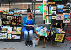 Hi mum, guess what... (Fr@nk //) Tags: street blue italy art apple topf25 girl collage florence mac chair topf50 acrylic italia sitting phone market sale telephone cellphone streetscene tuscany firenze toscana iphone commmunication mrtungsten62 frankvandongen wwworvilnl