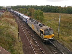 Class 92 No 92002 H.G. Wells in charge of the Stobart Rail Intermodal train passing through Eaglesfield on the WCML 17th Oct 2013 (penlea1954) Tags: uk electric train scotland no rail railway wells cargo class 92 freight hg intermodal eaglesfield wcml stobart 92002 kirtlebridge