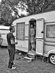 Circus Life: performers (and pet!) inside their caravan (sophie_merlo) Tags: circus people candid blackwhite circo cirque zirkus documentary photojournalism life caravan home
