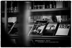 emergency exit 2 (ya.yuli) Tags: man buch 50mm bibliothek sw mann weiss schwarz helmutnewton bcher emergencyexit