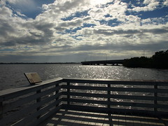 Take a break... (Shelby's Trail) Tags: sky water silhouette clouds fence river landscape 21 boardwalk caloosahatchee takeabreak hff brackish veteransbridge fencefriday fourmilecoveecopark