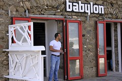 Babylon (oxfordblues84) Tags: red man building architecture bar painting beard greek doors entrance handsome hunk greece jeans painter facialhair bluejeans teeshirt babylon stud gaybar cyclades mykonos greekgod oldharbour shoreexcursion greekman whiteteeshirt babylonmykonos mykonosonfoot oldharbourmykonos greekgayguy