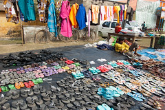 Untitled (Life in Frozen Frames) Tags: people india colour shop shoes child fair sell bengal seller chappal lifeinfrozenframes reemagill tamaghnasarkar 20140116dsc5342