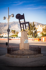 A Hat, A Chair, A Lamppost And A Trash Can (k009034) Tags: travel sky mountains lamp beautiful hat statue canon fence photography eos 350d spain chair market feria rail lamppost trashcan rebelxt carpark fuengirola beautifulearth