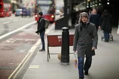 Cosy (renderdan) Tags: street city winter portrait urban man bus guy london hat sign canon prime dof bokeh roadworks candid 85mm 5d regents f12