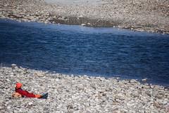 Travellers' Lounge (Vivek R. Singh: Visual Artist) Tags: blue india water river rocks photographer stones robe pebbles sage holy nomad hermit filmmaker ganga sadhu saffron ascetic ganges haridwar uttarakhand godman vivekrajsingh vivekrsinghvisualartist