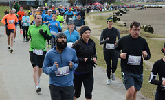 First Half Feb 16 2014 085523 (gherringer) Tags: canada vancouver race outdoors athletics downtown bc exercise britishcolumbia competition running seawall runners englishbay stanleypark colourful westend fit active bibs 211km 131mi vanfirsthalf 2014firsthalfhalfmarathon
