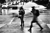 Should I stay or should I go? (. Jianwei .) Tags: street urban motion wet rain vancouver umbrella candid slowshutter waterfrontstation nex kemily nex6 more11536