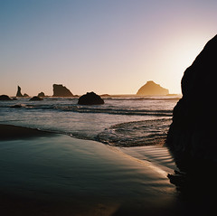 dreams of the sea, part five (manyfires) Tags: ocean sunset sea seascape film silhouette oregon analog mediumformat square golden coast waves glow tide shoreline hasselblad pacificocean shore pacificnorthwest coastline bandon pnw seastacks hasselblad500cm