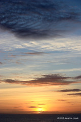 Sunset (Grand Turk) (runintherain) Tags: runintherain canon450dxsi canon canonxsi caribbean grandturkisland turksandcaicosislands tci britishoverseasterritory lucayanarchipelago island water ocean atlanticocean sea coast nature outdoor fromsea light clouds sky sun