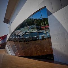 Refracted Reflections (RobMacPhotography) Tags: architecture national museum window deck canberra act australia texture reflections refraction people wood glass wall frame detail lines curves water sky sony a6000 rob mac photography panorama
