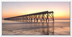 Steetley Dawn 2 (Lynne J Photography) Tags: pier sunrise pastel long exposure beach rapeseed dusk sunset chemicalbeach seaham wheels sand steetley dawn colors rocks sidelight