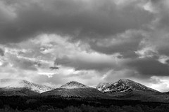 The north face of #BenNevis looking ominously beautiful this afternoon. At #Muirshearlach for family party 🎉   _______________________________________________________  #leicaq #lochaber #mountains #beautifulscotland #dramatic #blackandwhite  #insta_s