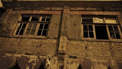 Afraid of the Dark? (Mars Mann) Tags: hauntedhouse spooky nightphotography urbancity haunted lowlight eerie marsmannphotography smashedwindows ruins abandoned empty urbanstreets urbanphoto urbanphotography olympusem1 olympuscamera olympusomd