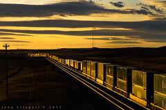 Sunset West of Cheyenne (Colorado & Southern) Tags: unionpacific emdsd70ace emdsd70m intermodal trains train railfanning railroad railfan railway railroads wyoming wyomingtrains wyomingrailroads transcontinental landscape overlandroute shermanhill sunset sun clouds railroading