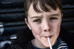 8 years old and sucking everything through a straw (markfly1) Tags: alfie son boy child children kids blue theme sucking life through straw freckles stripes d750 nikkor 50mm