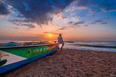 Contemplating (vasanthdavid) Tags: sunrise sunset dawn dusk alone happy vasanthdavid chennai marinabeach beach sand water sky clouds