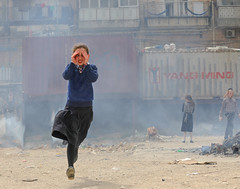 Running away… (ybiberman) Tags: israel jerusalem meahshearim passover girl ultraorthodox jew running smoke candid streetphotography